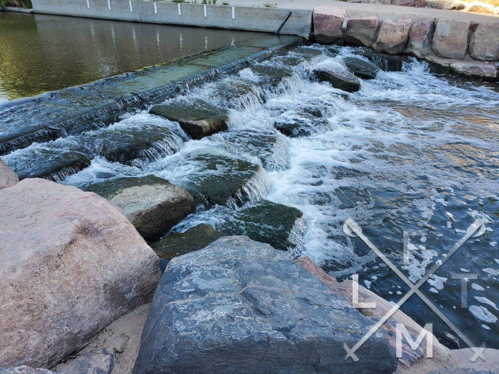 A man made water feature.  Cherry creek cascading down rocks to a lower level