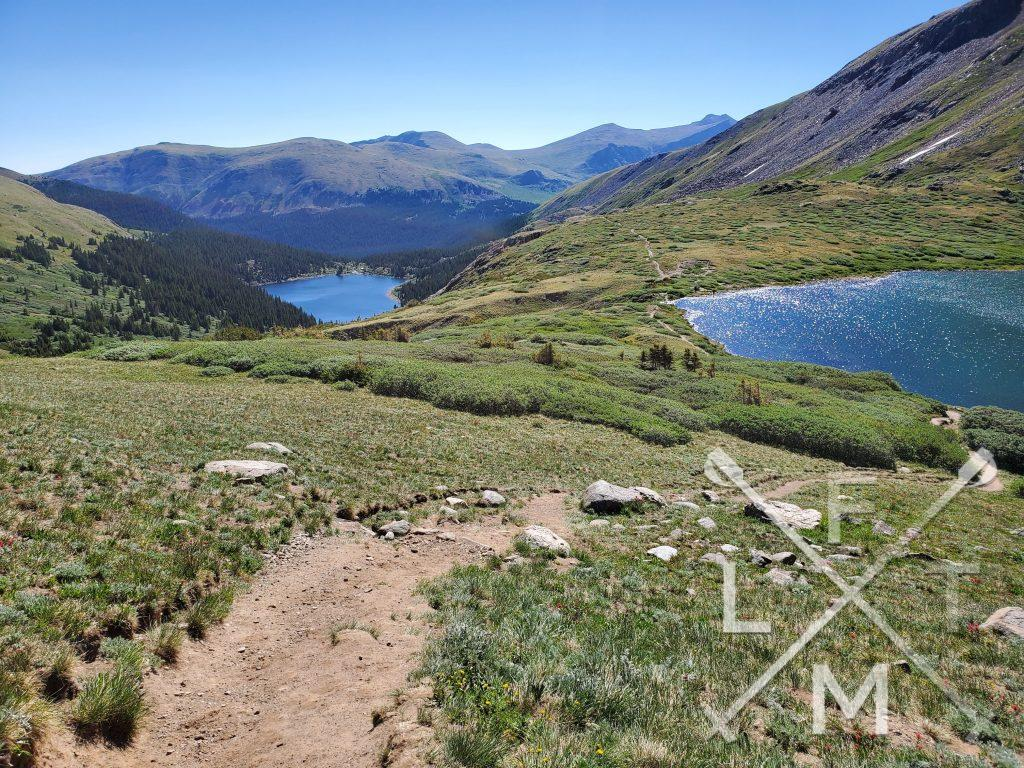 In Response to the interview with an adventurer portion of the Outstanding Blogger nomination I Chose this picture from Silver dollar lakes.  It shows two lakes tiered above each other and a trail leading to them.