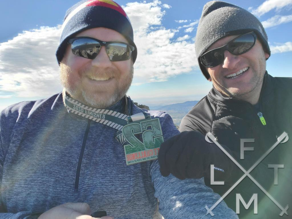 Me and my hiking mentor Scott.  Scott is holding my medal for finishing the 52 hike challenge.  The medal is around my neck.