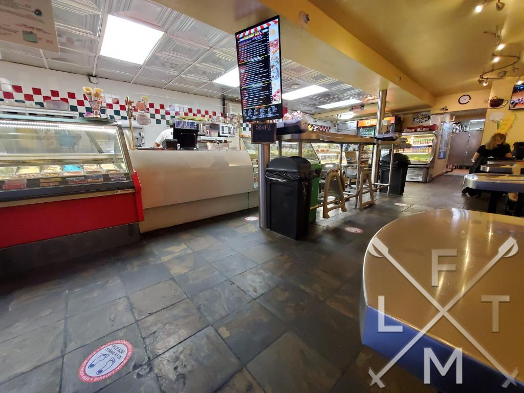 The inside of Joe's Deli resembles a New York style deli with a counter and grill and some sundries available to purchase as well