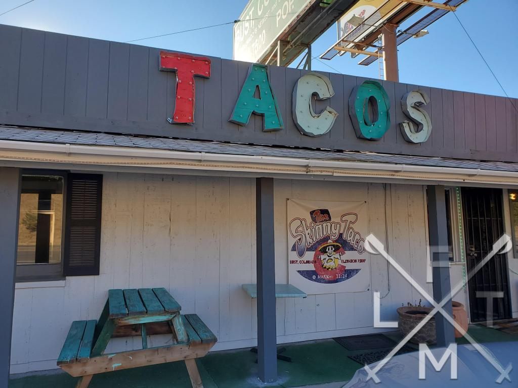 The simple sign saying TACO's sits above the door to the Skinny Taco.