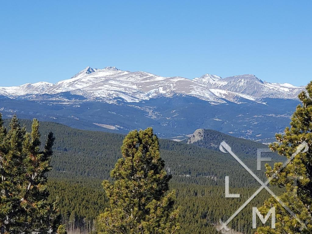 A snow covered mountain range to the north of panorama point