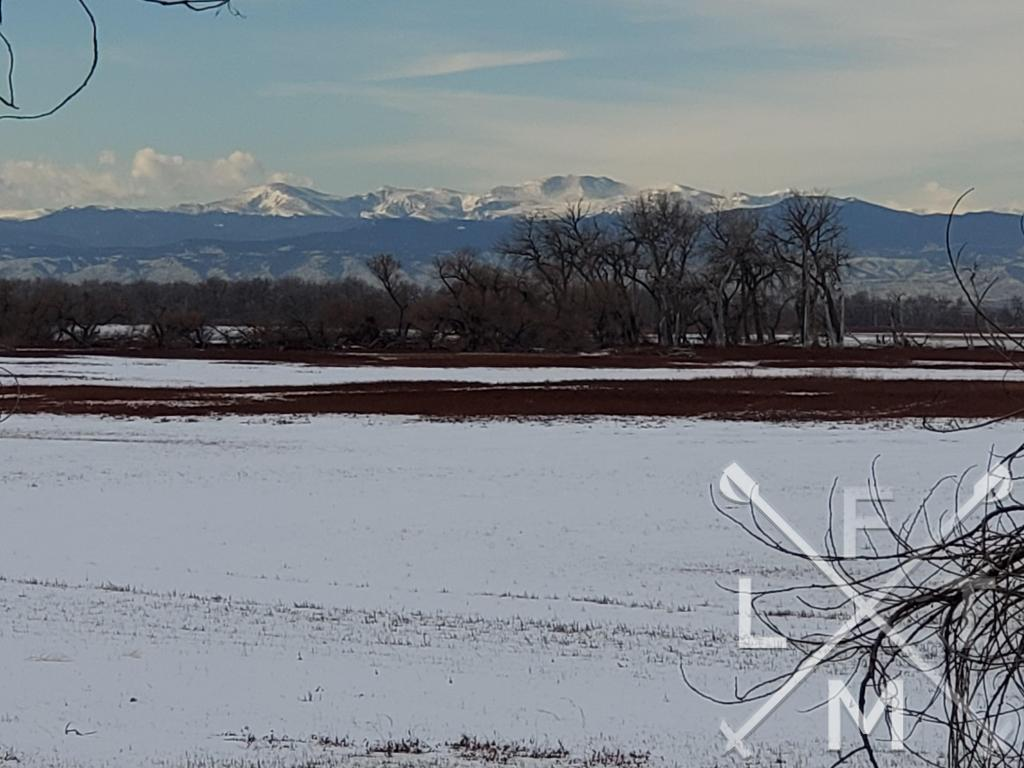The view across the half frozen Barr lake with the mountains in the background.