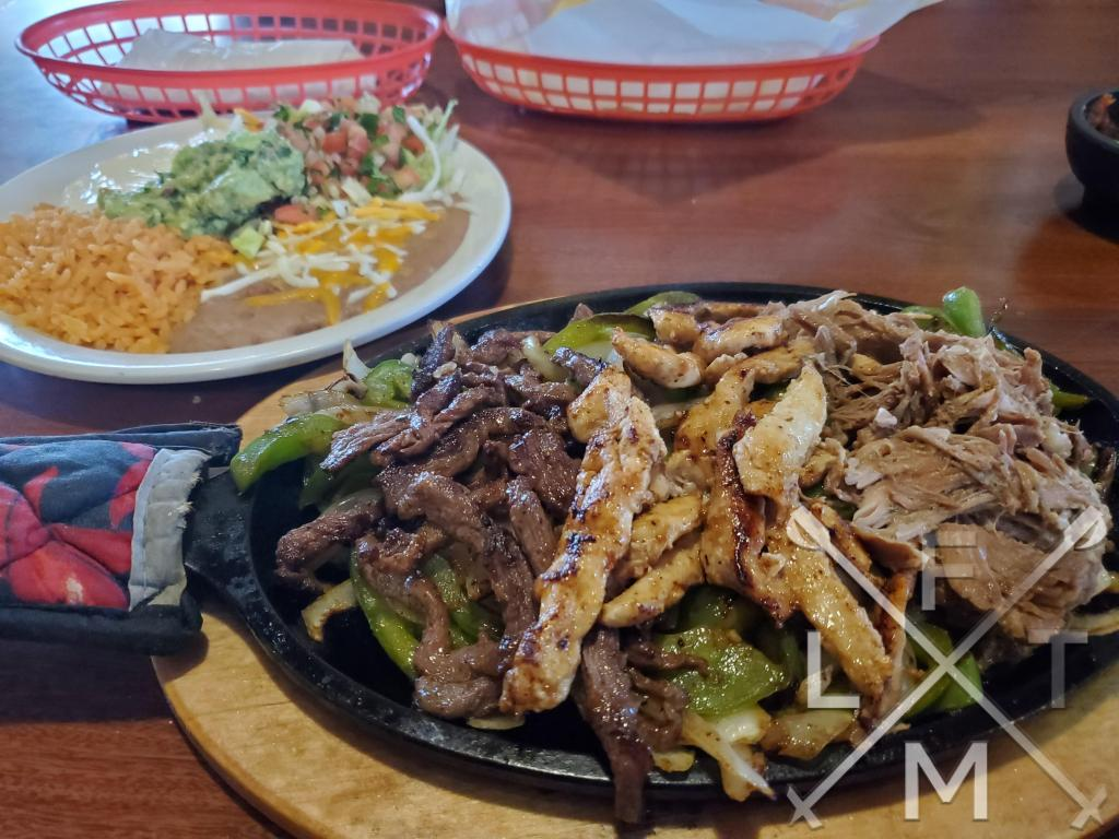 The 3 Charrito's Fajitas combo. Steak, Chicken and Carnitas over peppers and onions from Charrito's House in Larkspur
