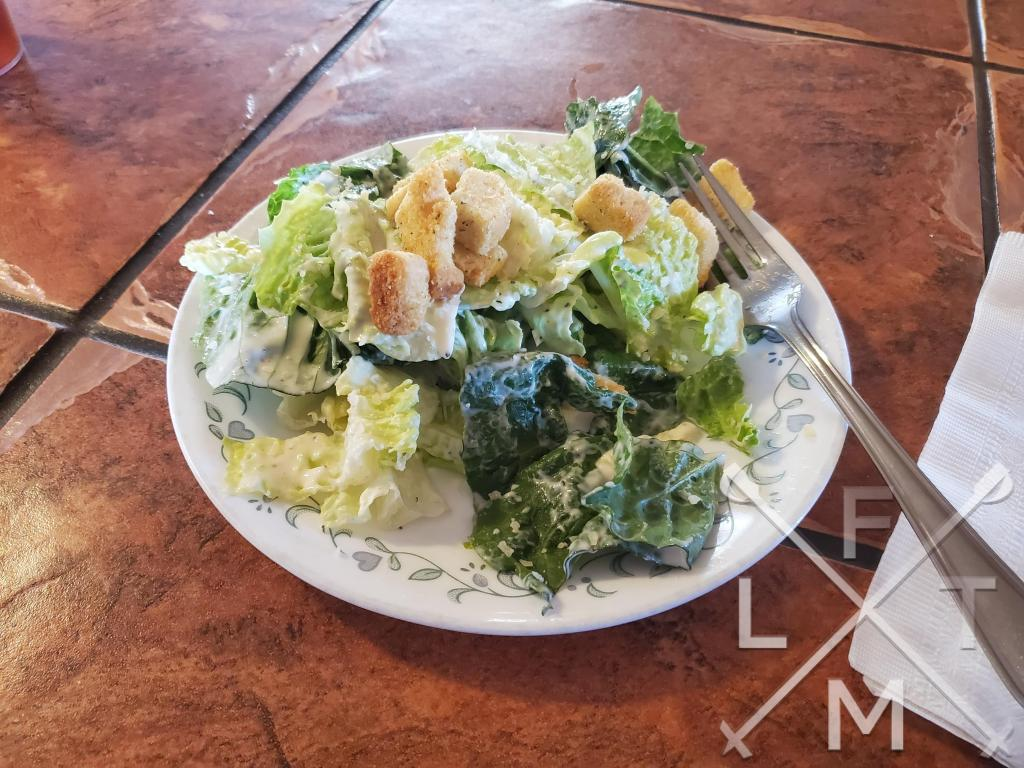 A side Caesar salad from Larkspur Pizzaria and cafe.