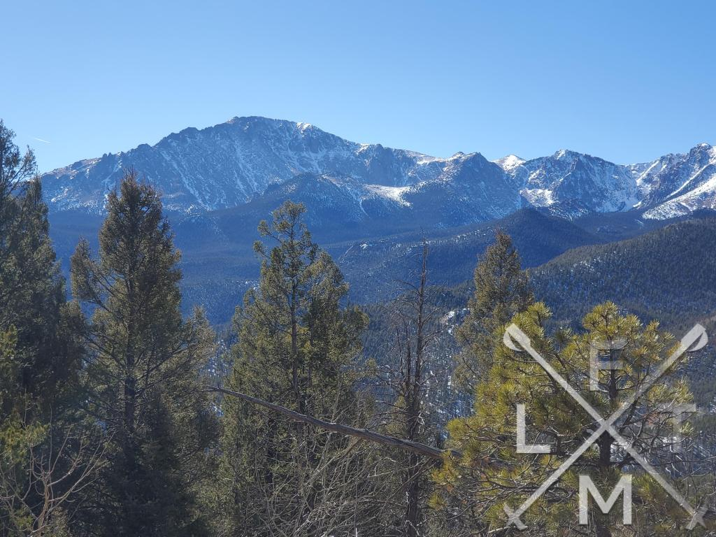 Pikes Peak and the surrounding rocky mountain tops from a spot on the ridgeline on the way to Mt. Esther.