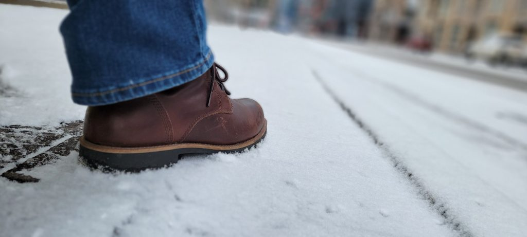 The Kodiak Moncton boot standing in snow on the street corner