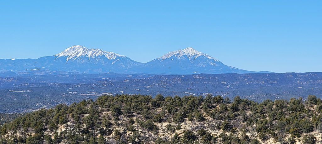 The Spanish peaks from about 2/3 of the way up the Challenge Trail at Fisher's Peak State park.  This picture shows the two large peaks at the north end of the range.