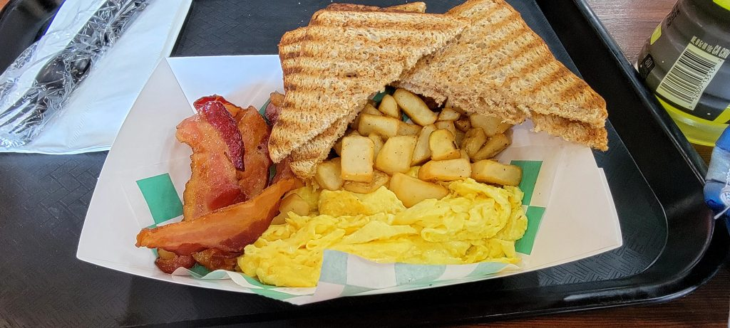 The All American Breakfast with scrambled eggs, bacon toast and potato's.