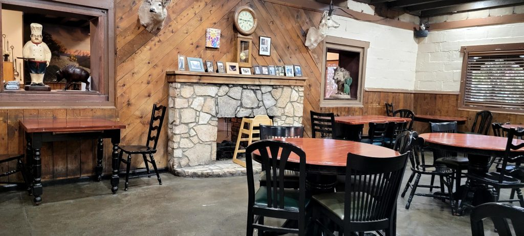 The dining room with a large wood fireplace with animal heads mounted over it at the Rock Springs Cafe.
