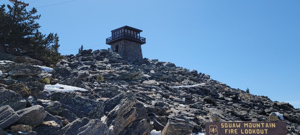 The Squaw Mountain fire lookout station sitting at the peak of Squaw Mountain.